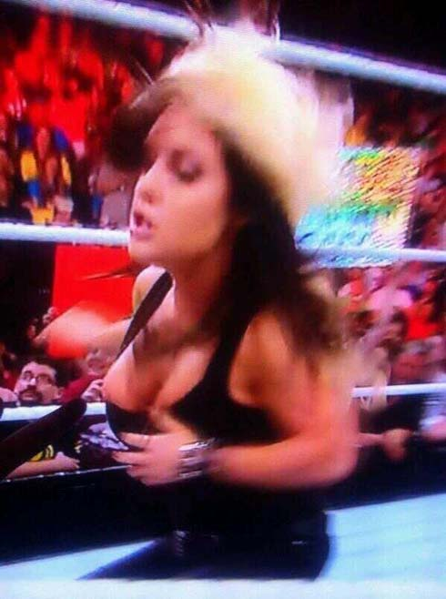 Kaitlyn suffers wardrobe malfunction while attacking AJ