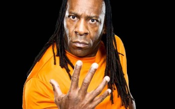 Team Teddy members perform spinaroonies with Booker T at Smackdown