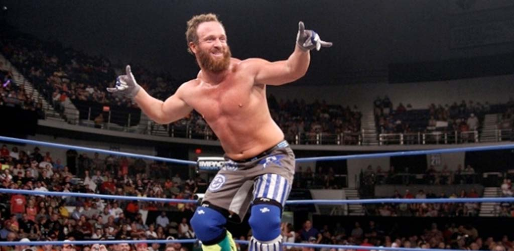 Eric Young retains TNA title in three way steel cage match