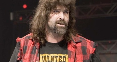 Mick Foley ejected from chicken wings eating contest for cheating!