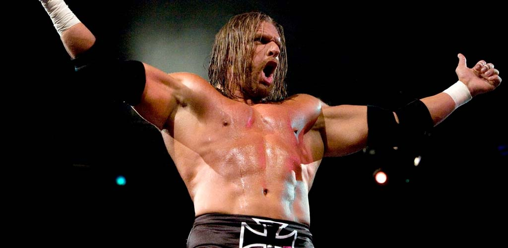 Triple H chops off his long hair!