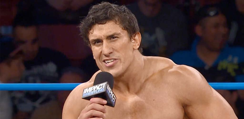 Ethan Carter III crashes EVOLVE show, launches attack on Triple H and NXT