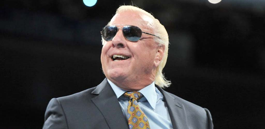 "Ric Flair ""awake"" and ""communicating"" in hospital"