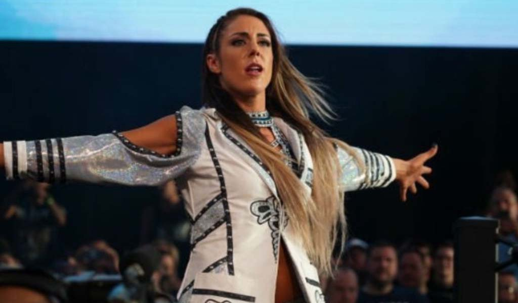 AEW takes a dig at NXT by recreating the scene of Britt Baker at ringside from Takeover