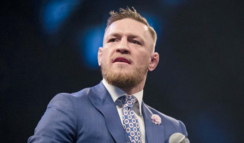 Conor McGregor congratulates Becky Lynch and puts over Rousey and Flair