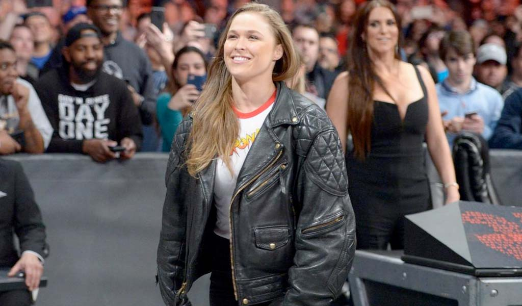 Ronda Rousey suplexes Triple H…and gets slapped by Stephanie McMahon
